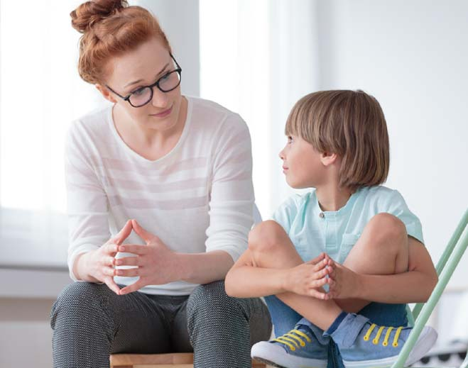 therapist talking with child